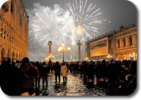 Fireworks go off over a flooded Venice